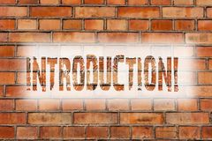 Writing note showing Introduction. Business photo showcasing First part of a document Formal presentation to an audience Brick. Wall art like Graffiti royalty free stock photos