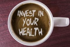 Writing note showing Invest In Your Health. Business photo showcasing Spend money in personal healthcare Preventive Tests written. Coffee in White Cup the royalty free stock photo