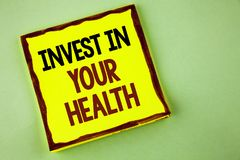 Writing note showing Invest In Your Health. Business photo showcasing Spend money in personal healthcare Preventive Tests written. Yellow Sticky note paper royalty free stock images