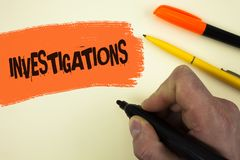 Writing note showing  Investigations. Business photo showcasing Formal inquiry Systematic Study Examination Research Analysis writ. Ten by Man holding Marker Stock Image