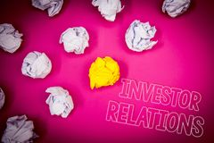 Writing note showing Investor Relations. Business photo showcasing Finance Investment Relationship Negotiate Shareholder Pink gro. Und white paper lumps shadow stock image