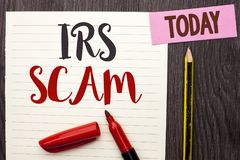 Writing note showing  Irs Scam. Business photo showcasing Warning Scam Fraud Tax Pishing Spam Money Revenue Alert Scheme written o Stock Photos
