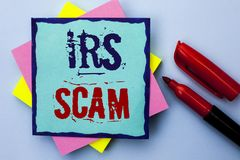 Writing note showing  Irs Scam. Business photo showcasing Warning Scam Fraud Tax Pishing Spam Money Revenue Alert Scheme written o Royalty Free Stock Images