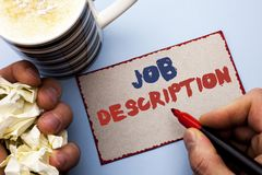 Writing note showing  Job Description. Business photo showcasing Document that establishes duties requirements exprerience written. By Man Cardboard Piece Royalty Free Stock Images
