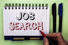 Writing note showing Job Search. Business photo showcasing Find Career Vacancy Opportunity Employment Recruitment Recruit written. By Man Holding Marker royalty free stock photography