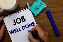 Writing note showing Job Well Done. Business photo showcasing Well Performed You did it Cheers Approval Par Accomplished. Man holding marker notebook clothespin stock image