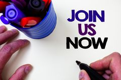 Writing note showing Join Us Now. Business photo showcasing Enroll in community Register in website or form Recruit Blue pen hold. Er white background shadow stock image