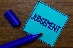 Writing note showing Judgement. Business photo showcasing ability make considered decisions come to sensible conclusions. Blue Paper Important reminder stock photos
