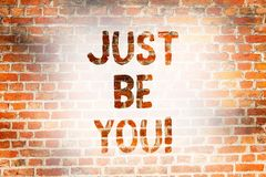 Writing note showing Just Be You. Business photo showcasing Keep being authentic unique yourself Motivation Inspiration. Brick Wall art like Graffiti royalty free stock photos