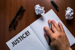 Writing note showing Justice. Business photo showcasing impartial adjustment of conflicting claims or assignments Man royalty free stock image
