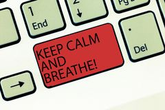 Writing note showing Keep Calm And Breathe. Business photo showcasing Take a break to overcome everyday difficulties. Keyboard Intention to create computer stock photo