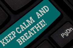 Writing note showing Keep Calm And Breathe. Business photo showcasing Take a break to overcome everyday difficulties. Keyboard key Intention to create computer stock photos