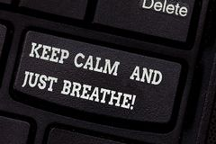 Writing note showing Keep Calm And Just Breathe. Business photo showcasing Take a break to overcome everyday. Difficulties Keyboard key Intention to create royalty free stock photos