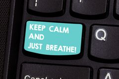 Writing note showing Keep Calm And Just Breathe. Business photo showcasing Take a break to overcome everyday. Difficulties Keyboard key Intention to create stock photography
