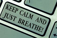 Writing note showing Keep Calm And Just Breathe. Business photo showcasing Take a break to overcome everyday. Difficulties Keyboard key Intention to create stock photo
