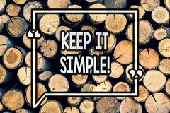 Writing note showing Keep It Simple. Business photo showcasing Simplify Things Easy Clear Concise Ideas Wooden background vintage. Wood wild message ideas royalty free stock images