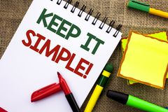 Writing note showing  Keep It Simple Motivational Call. Business photo showcasing Simplify Things Easy Clear Concise Ideas written. Notebook Book the jute Royalty Free Stock Image