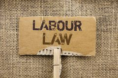 Writing note showing  Labour Law. Business photo showcasing Employment Rules Worker Rights Obligations Legislation Union written o. Writing note showing  Labour Stock Photo