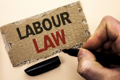 Writing note showing  Labour Law. Business photo showcasing Employment Rules Worker Rights Obligations Legislation Union written b. Y Man Holding Marker tear Stock Images