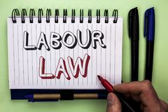Writing note showing  Labour Law. Business photo showcasing Employment Rules Worker Rights Obligations Legislation Union written b. Y Man Holding Marker Nootbook Royalty Free Stock Images