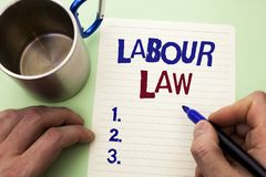 Writing note showing  Labour Law. Business photo showcasing Employment Rules Worker Rights Obligations Legislation Union written b. Y Man Notebook Paper Holding Royalty Free Stock Photography