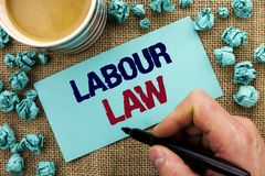 Writing note showing  Labour Law. Business photo showcasing Employment Rules Worker Rights Obligations Legislation Union written b. Y Man Holding Pen Sticky Note Royalty Free Stock Images