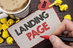 Writing note showing  Landing Page. Business photo showcasing Website accessed by clicking a link on another web page written Man. Holding Marker Cardboard Stock Images