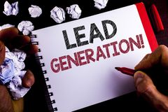 Writing note showing  Lead Generation Motivational Call. Business photo showcasing Sales pipeline digital generating leads written. By Man Notepad holding Stock Image