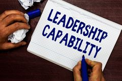 Writing note showing Leadership Capability. Business photo showcasing what a Leader can build Capacity to Lead. Effectively Man holding marker notebook page stock image