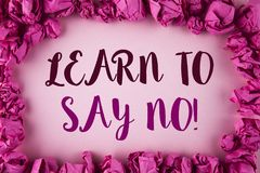 Writing note showing Learn To Say No Motivational Call. Business photo showcasing Encouragement advice tips morality values writt. En plain background within stock photography