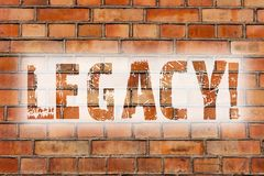 Writing note showing Legacy. Business photo showcasing Transmitted Received from an ancestor Money Properties given by will Brick. Wall art like Graffiti stock photo