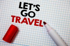 Writing note showing  Let\'S Go Travel. Business photo showcasing Going away Travelling Asking someone to go outside Trip Graph pa. Per grey important thoughts Royalty Free Stock Images