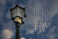 Writing note showing Let 'S Go Travel. Business photo showcasing Going away Travelling Asking someone to go outside Trip Light po royalty free stock images