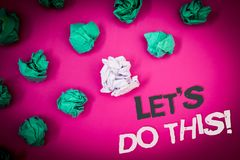 Writing note showing  Let Us Do This Motivational Call. Business photo showcasing Encourage to start something Inspirational Text. Words pink background Royalty Free Stock Photos