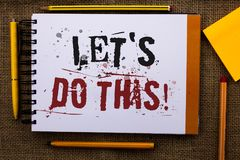 Writing note showing  Let Us Do This Motivational Call. Business photo showcasing Encourage to start something Inspirational Text. White notepad yellow pen Royalty Free Stock Photos