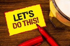 Writing note showing Let Us Do This Motivational Call. Business photo showcasing Encourage to start something Inspirational Words. Yellow paper note red border stock photos