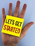 Writing note showing Lets Get Started. Business photo showcasing beginning time motivational quote Inspiration encourage written. Sticky Note Paper the plain royalty free stock photography