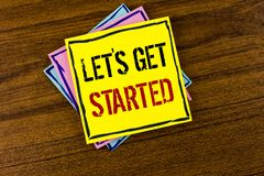 Writing note showing Lets Get Started. Business photo showcasing beginning time motivational quote Inspiration encourage written. Yellow Sticky Note Paper the royalty free stock image