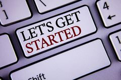 Writing note showing Lets Get Started. Business photo showcasing beginning time motivational quote Inspiration encourage written. White keyboard key with copy stock image