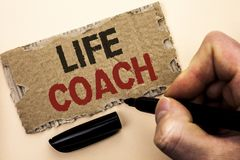 Writing note showing  Life Coach. Business photo showcasing Mentoring Guiding Career Guidance Encourage Trainer Mentor written by. Man Holding Marker tear Royalty Free Stock Images