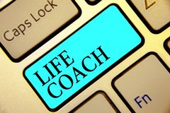 Writing note showing Life Coach. Business photo showcasing A person who advices clients how to solve their problems or goals Keybo. Ard blue key Intention stock photo