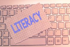 Writing note showing Literacy. Business photo showcasing ability to read and write competence or knowledge in specified area stock images