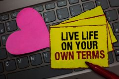Writing note showing Live Life On Your Own Terms. Business photo showcasing Give yourself guidelines for a good living Red bordere. D yellow written paper pinch stock images