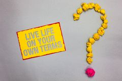 Writing note showing Live Life On Your Own Terms. Business photo showcasing Give yourself guidelines for a good living Red bordere. D yellow sticky note yellow stock photography