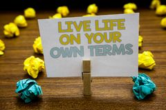 Writing note showing Live Life On Your Own Terms. Business photo showcasing Give yourself guidelines for a good living Written not. Epad stand with paperclip stock photography