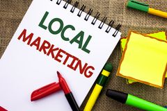 Writing note showing  Local Marketing. Business photo showcasing Regional Advertising Commercial Locally Announcements written on Royalty Free Stock Images
