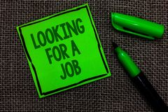 Writing note showing Looking For A Job. Business photo showcasing Unemployed seeking work Recruitment Human Resources Black lined. Green sticky note with words stock photos