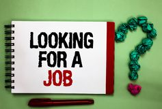 Writing note showing Looking For A Job. Business photo showcasing Unemployed seeking work Recruitment Human Resources Celadon colo. R background red sided stock images