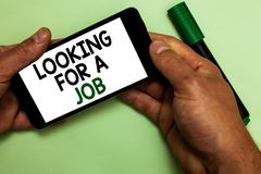 Writing note showing Looking For A Job. Business photo showcasing Unemployed seeking work Recruitment Human Resources Human hand h. Old iPhone with texts touched royalty free stock photo