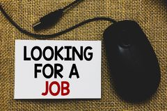 Writing note showing Looking For A Job. Business photo showcasing Unemployed seeking work Recruitment Human Resources Traditional. Mouse alongside white page stock photo